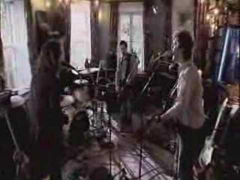 Tekst piosenki The Frames - Falling Slowly po polsku