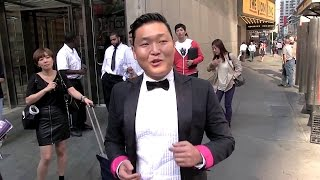 (EXCLUSIVE) PSY in Time square arriving at MTV Studios in New York City