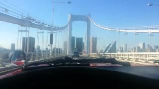 Phoenix James on Rainbow Bridge crossing Tokyo Bay in Japan