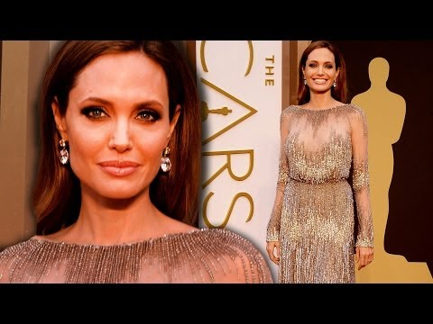 red carpet - Oscars arrivals gallery: http://bit.ly/1kpO5rq http://bit.ly/SubClevverStyle - Subscribe to ClevverStyle! Angelina Jolie shined in a metallic and sheer gown ...