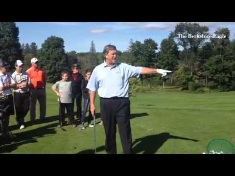 Professional Golfer Peter Jacobsen gives clinic to high school player at Pittsfield Country Club.