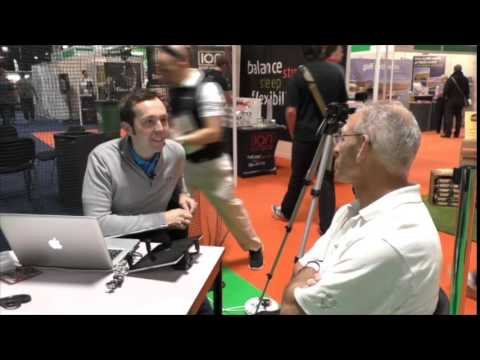 Rick Shiels gives Ian Harris a golf lesson at Manchester Golf Show 2015
