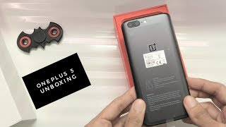 OnePlus 5 6GB Slate Gray Variant - Unboxing and First Look.Subscribe here for more OnePlus 5 videos:- http://bit.ly/subGizmoThe OnePlus 5 is finally out in the market and with a price of Rs.32999, it is definitely not a cheap phone. It's the Flagship phone of OnePlus and it offers one of the best specification set that's available right now. In this video, we will be unboxing and checking out the Slate Grey variant of this phone. So sit back, relax and enjoy this video.Please Like and share my video if you liked it! Subscribe for more quality reviews!Follow me on my Social Media too.The links are given below.Thanks for watchinghttp://facebook.com/gizmoddicthttp://instagram.com/gizmoddicthttp://twitter.com/gizmoddictMusic Used is Licensedhttps://soundcloud.com/aka-dj-quads