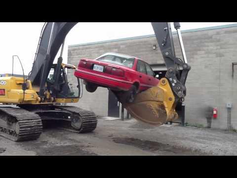 John Deere Shovel vs. 92 Corolla