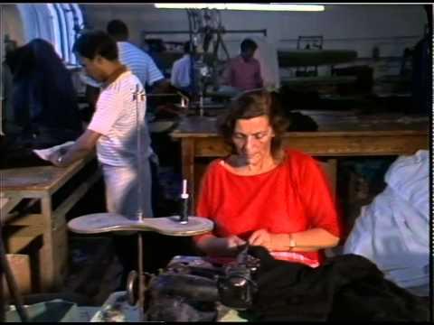 HACKNEY SWEAT SHOPS. 21.9.87 -WOMEN WORKING SOWING MACHINES. MEN IRONING
