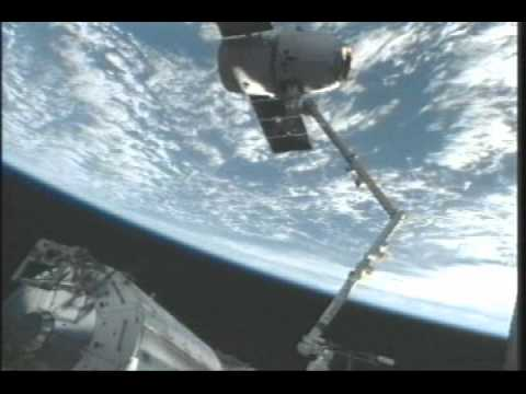 the station - The Expedition 31 crew used the Canadarm2 robotic arm to demate the SpaceX Dragon cargo vehicle from the Earth-facing port of the station's Harmony node at 4...