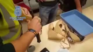 The Policía Nacional Española find 180000 Euros in a Woman's Platform Shoes. She was trying to smuggle Euros into Spain.