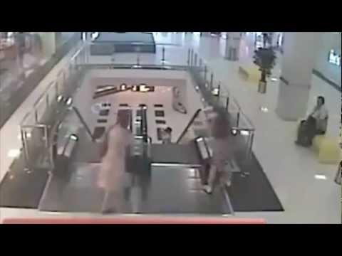 Three Year-Old Boy Falls Three Stories Off of Escalator in Russian Mall
