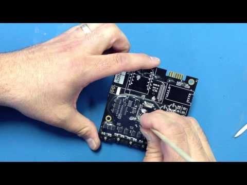 UV conformal coating - This video shows how to remove the conformal coating from the pins on a microprocessor.