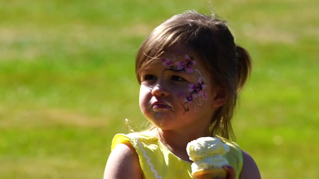 YouTube placeholder image shows still from video of a child eating icecream in the park.