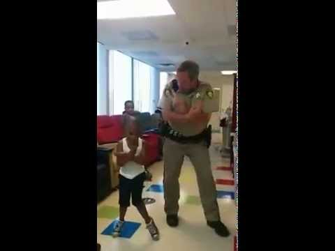 Caught - Caught in the act! LVMPD Officer Tim Fletcher was caught on camera bustin' a move. On a recent visit to the Cure 4 the Kids Foundation this week, Officer Fletcher chatted with a young man...