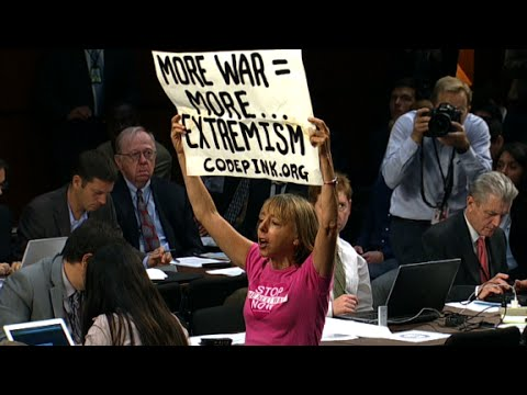 from - Protesters interrupted a Senate hearing with Defense Secretary Chuck Hagel and General Martin Dempsey on ISIS.