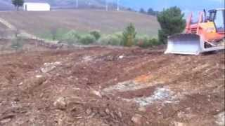 This video shows how using a bulldozer and an excavator you can prepare the soil to plant grape vines.