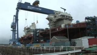 The UK's biggest aircraft carrier has moved a step closer to completion after its 750-tonne control tower was lowered on to the...
