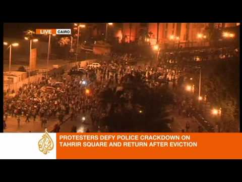 tahrir tents - Egyptian soldiers and police set fire to tents in the middle of Cairo's Tahrir Square and fired tear gas and rubber bullets in a major assault on Sunday to d...