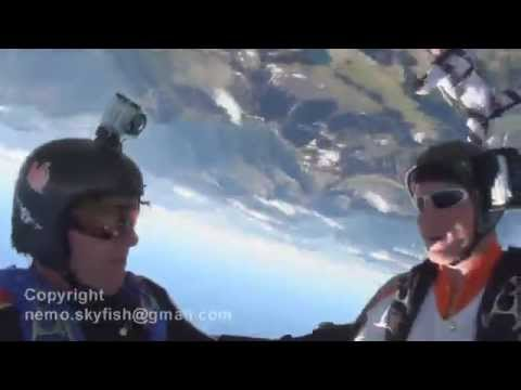 Skydivers low pull over mountain top