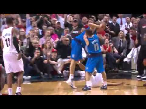 Game 4: Andre Miller and Dirk Nowitzki fight for the ball