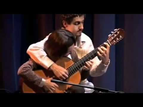 Amazing Four Hands Guitar   Funny Videos at Videobash