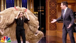 Jimmy gives Drew Barrymore a chance to break official Guinness World Records like most lipstick applications in 30 seconds and wearing the world's widest wig ...