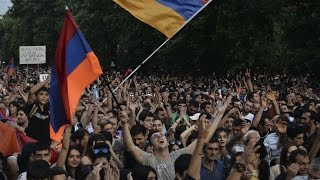Live Protesters holding ground against rising electricity prices in a central Yerevan