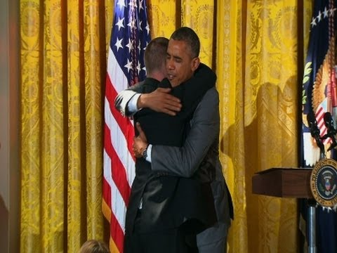 gets - During an event at the White House honoring the Special Olympics, President Barack Obama received a hug from Tim Harris, a Special Olympian and owner of a restaurant called Tim's Place. (July...