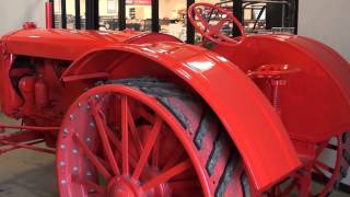 1. Antique Tractors and International Scout II at the Local Equipment Dealer