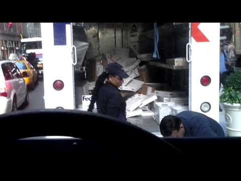 fedex employee flings packages onto truck gets caught on film consumerist. Black Bedroom Furniture Sets. Home Design Ideas
