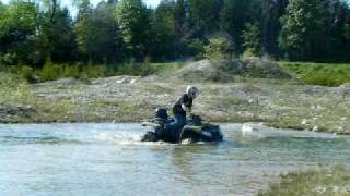 4. 2010 arctic cat trv 550 playin in water