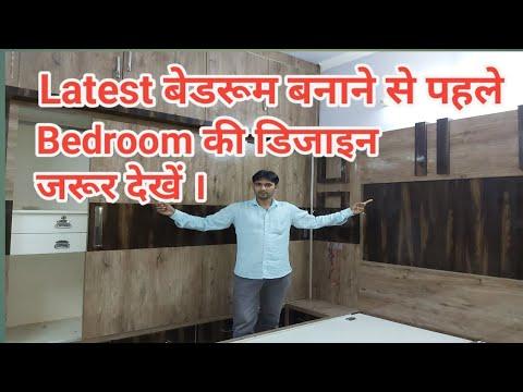 Latest Bedroom Design 10 'x 12' sliding Wardrobe design with attached dressin cabinet TV unit design