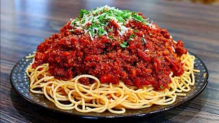 How to make Spaghetti Bolognese just got Delissh with my Bolognese sauce and Spaghetti recipe. This easy Italian pasta recipe is so delicious and worth every time. Make a spaghetti bolognese recipe for your friends and family and they will love you more!!! INGREDIENTS 1lb  ground beef 1 medium onion (shredded or grated)3 single stalks celery, about 1/2 cup (shredded or grated) 3 medium carrots (shredded or grated)Minced garlic, about 3 cloves  salt and pepper to taste 1/4 tsp ground nutmeg1 tsp Italian seasoning 1/2 cup Red wine (your favorite) 15 oz can diced tomatoes 24 oz can tomato puree handful fresh basil 1lb spaghetti pasta 1/4 cup parmesan cheese SUBSCRIBE AND CLICK THE BELL FOR VIDEO NOTIFICATIONS