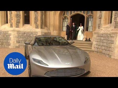 Princess Beatrice helps Princess Eugenie into Aston Martin