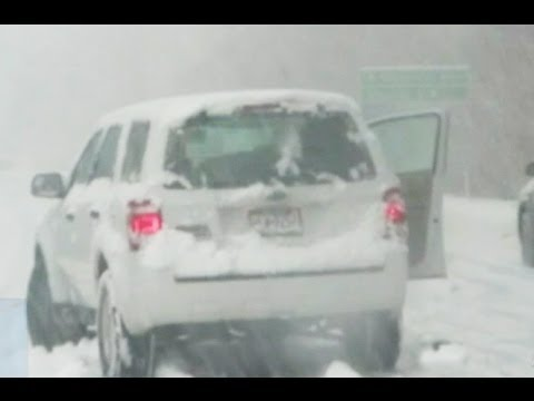 weather - Ice and up to a foot of snow cause highway rescues and deadly accidents.