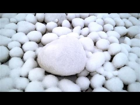 Giant Snowballs Appear on Siberian Beach