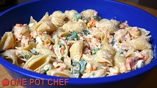 """My Ultimate Creamy Pasta Salad is an amazing side dish, suitable for parties, barbecues, pot lucks or just as an everyday side dish! Pasta is combined with a delicious dressing, crispy bacon, corn and more! Quick and easy to prepare, the whole family will love it! Try it today :)Ingredients:400g of Small Pasta (I used Shells, cooked following packet instructions)1 Cup of Diced Bacon4 Spring Onions (thinly sliced)2 Small Carrots (grated)2 x 125g Cans of Sweet Corn (drained)2/3 Cup of Garlic Aioli (or Whole Egg Mayo)1/3 Cup of Sour CreamSalt and PepperPreparation Time: About 20 minutes (plus chilling time)Cooking Time: About 10 minutesSERVES 8Subscribe to One Pot Chef (it's free!):http://bit.ly/SubOPCONE POT CHEF COOKBOOKS - PAPERBACKS AND EBOOKS:http://www.lulu.com/spotlight/onepotchefONE POT CHEF COOKBOOKS ON iTUNES BOOKSTORE:http://itunes.apple.com/au/artist/dav...ONE POT CHEF APRONS + T-SHIRTS NOW AVAILABLE!http://shop.studio71us.com/collection...Filmed in 4K using the Sony FDRAX100 Video Camera - Check it out here:https://goo.gl/iHLnHPFollow me on Social Media:Twitter:http://www.twitter.com/onepotchefFacebook:http://www.facebook.com/onepotchefInstagram: http://www.instagram.com/onepotchefshowMusic Credits:""""Bright Wish""""by Kevin MacLeodhttp://incompetech.comRoyalty Free Music - Used with Permission under Creative Commons license."""