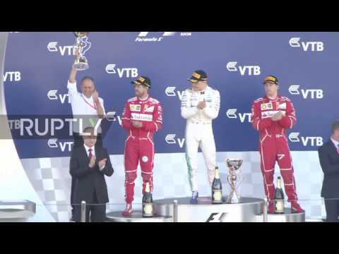 Russia: Putin attends Sochi Formula One race, meets with F1 CEO Carey