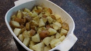 Cut up potatoes and onions, put in microwave for 8 minutes...remove, add butter, olive oil, granulated garlic and dill...stir, cover and put in 375 degree oven for ...