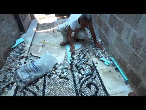 Traditional Greek pebblestone mosaic artist Stelios Grekos at work [4:18]