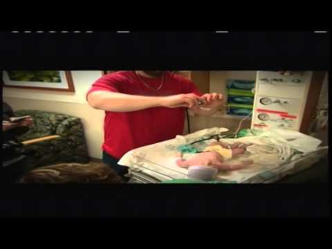 Father drops phone on newborn baby