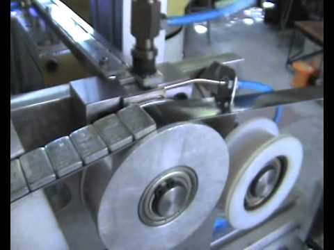 Auswuchtgewichte / Sticking of balance weights for automotive industry over a self-adhesive tape
