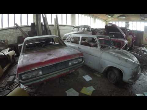 Abandoned garage with classic cars inside. (4K Ultra HD)