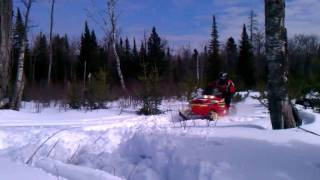 9. Uncle does a jump with his 2004 polaris RMK 800