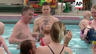"""(15 Jul 2017) LEADINAn Icelandic developmental therapist is helping babies less than four months old to stand on their own.The astonishing feat takes place in a local swimming pool near Reykjavik to the delight of the babies' parents. STORYLINE : At this swimming pool, instructor Snorri Magnusson's young pupils are performing remarkably for their age.Thanks to his techniques, babies as young as 3.5 months old are able to stand unaided.  Usually this doesn't happen until around nine or ten months old. Magnusson became Iceland's first baby swimming instructor in 1990 and he's been perfecting his unusal methods since then. Babies attending this course take a twice weekly, twelve-week one hour swimming class.Soon most of the young students are able to stand, either balancing in Magnusson's hands or on top of a corkboard.Magnusson says the secret is strengthening the babies' spine and upper bodies.  """"The parents are always very surprised. Really surprised by what their babies are able to do. But it always starts with the straight training. So when the kids come first they have homework to do in order to strengthen their spine. Because when there is strength in the spine and the upper body you can do whatever. And also the babies are sometimes the first to start talking, to start smiling. We work with that during the class."""" Earlier this year Magnusson teamed up with professor of neuropsychology Hermundur Sigmundsson from the the Norwegian University of Science and Technology to carry out an official study on what goes on during the classes. Sigmundsson's results were published earlier this year in the peer-reviewed journal 'Frontiers in Psychology'. 11 out of the 12 babies who participated were able to stand up without assistance for at least 15 seconds by the end of the 12 week course. The remaining baby only managed to stand for about eight seconds.The average age of the children was 4.3 months, with the youngest only 3.6 months old.The babies do warm up exercises assi"""