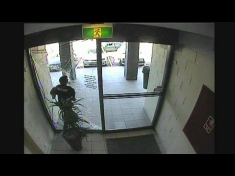 WATCH: Bag snatcher crashes through glass then escapes