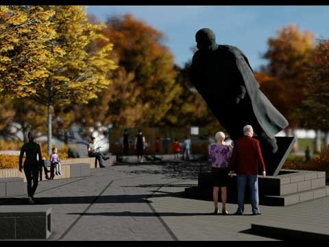 View of Memorial site featuring a large statue of Vladimir Lenin that appears to be toppling forward.