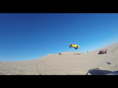 Truck catches massive air in the sand dunes