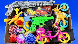 Box Full of Toys Change Colors Squishy Balls   Whats in the Box ? Lots of Guns Toys from Box of Toys