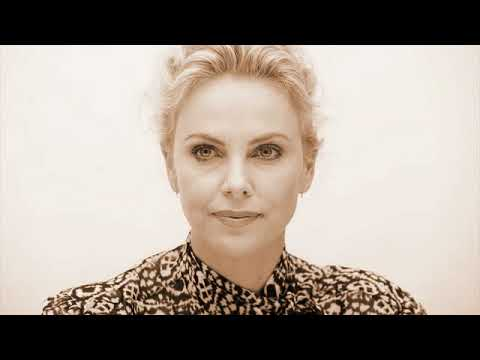 charlize theron an americon actoress looking awasome with her golden hairs and blue eyes