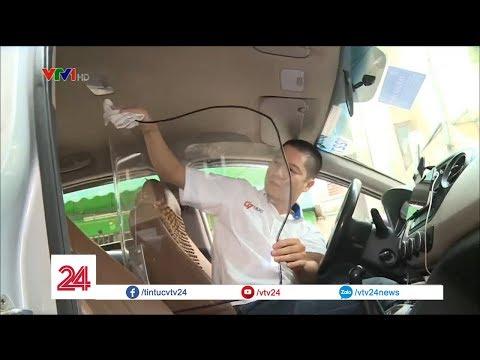 Lái xe taxi lắp vách ngăn để tự bảo vệ  @ vcloz.com