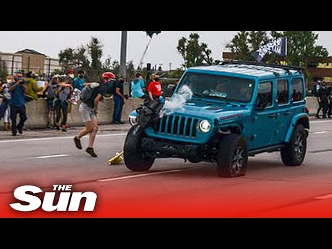 Jeep mows into Black Lives Matter march before protester fires gun, injuring two people in Colorado
