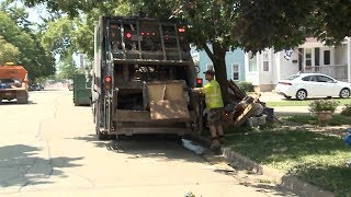 Keepsakes turned into soggy piles on the streets in Burlington as residents continued the task of cleaning up and repairing their lives after last week's devastating flood.